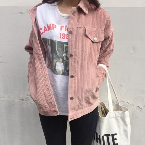 With t-shirt, black pants and white tote