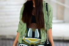 With top, printed mini skirt, mint green jacket and chain strap bag