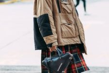 With two colored oversized jacket, plaid dress, jeans and black leather bag
