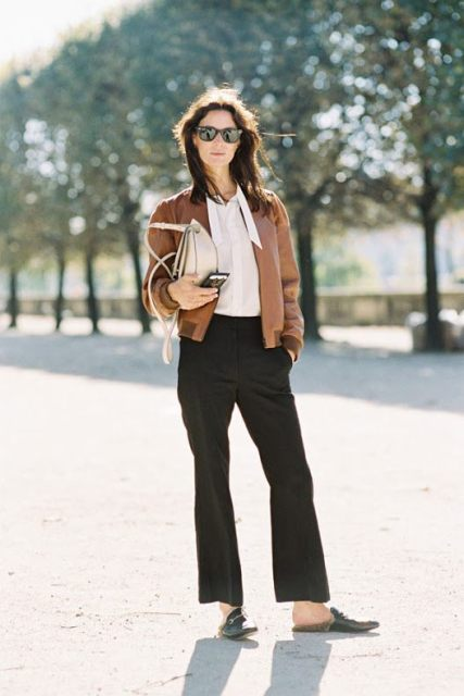 With white blouse, wide leg trousers, beige bag and flat shoes
