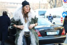 With white shirt, black leather pants and fur parka coat