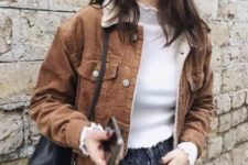 With white shirt, jeans and black leather bag