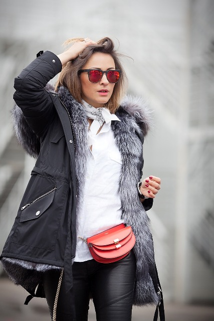 With white shirt, leather pants and fur parka coat