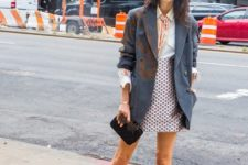 With white shirt, polka dot skirt, clutch and long blazer