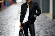 With white t-shirt, leather skinny pants, big bag and ankle boots