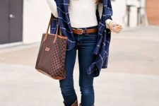 With white turtleneck, plaid scarf, printed tote and jeans