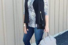 animal print long sleeve, a black waistcoat, blue jeans, black peep toe booties and a greay bag