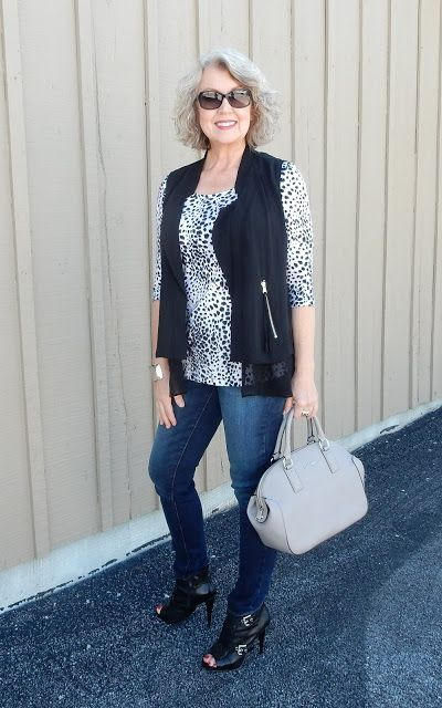 animal print long sleeve, a black waistcoat, blue jeans, black peep toe booties and a greay bag
