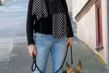 blue distressed cropped jeans, a black sweater and a polka dot scarf, black flats