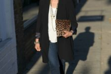 navy cropped jeans, a white top, an oversized black blazer, grey peep toe booties and a leopard clutch