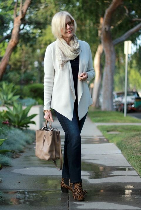 navy jeans, a black tee, leopard print booties, a brown bag and a creamy cardigan plus a scarf