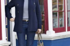 navy jeans, a grey turtleneck, a navy cardigan, brown tall boots and a bag