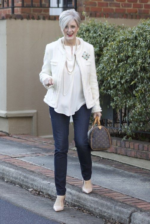 navy jeans, nude heels, a white top, a white blazer, layered necklaces and a classic bag