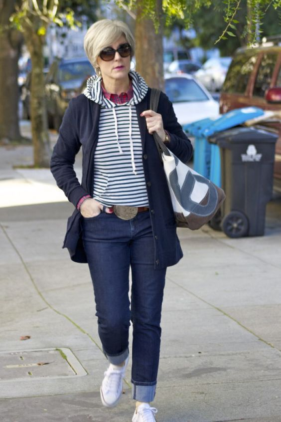 navy jeans, white sneakers,, a striped hoodie, a plaid shirt, a navy cardigan for a comfy weekened look