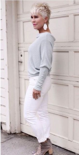 white skinnies, a grey cowl sweater, brown booties and tassel earrings for fall neutrals