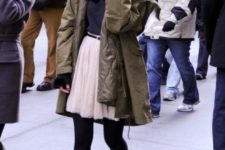 02 a black tee, a blush skirt, black tights and combat boots, an olive parka for a girlish feel