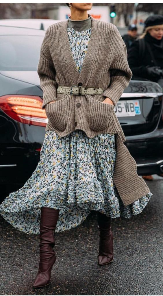 a floral dress with a high low skirt, a grey turtleneck, burgundy boots, a grey high low cardigan with a belt for a statement