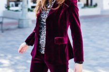 02 a plum-colored velvet pantsuit, a silver sequin top, a black bag for a cheery holiday look