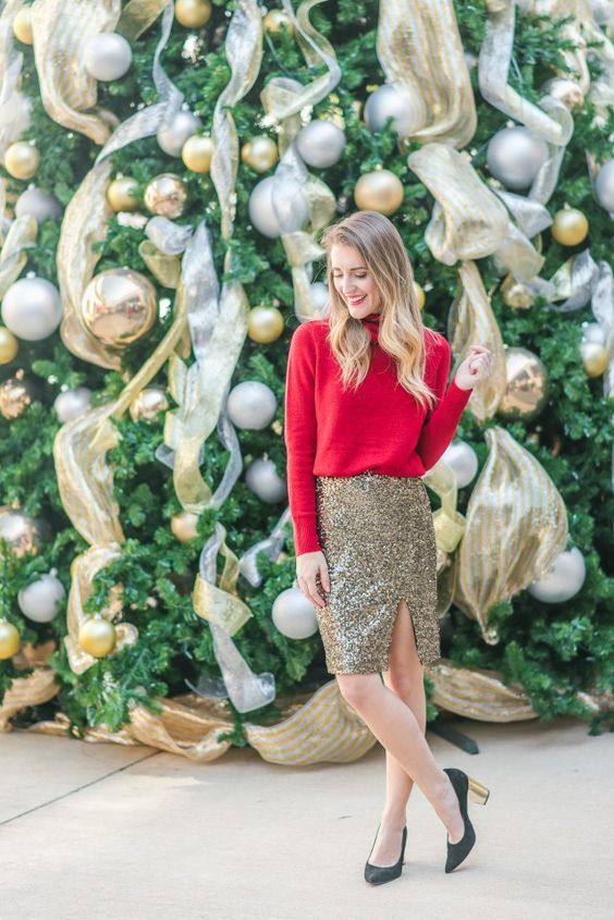 a red turtleneck sweater, a gold sequin knee skirt with a side slit, black shoes with metallic heels