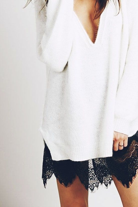 a white sweater with a low V-neck and a black lace attachment is very untrendy right now