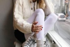 02 a white tee, black shorts, a creamy cardigan, white boots, white tights for a modern look