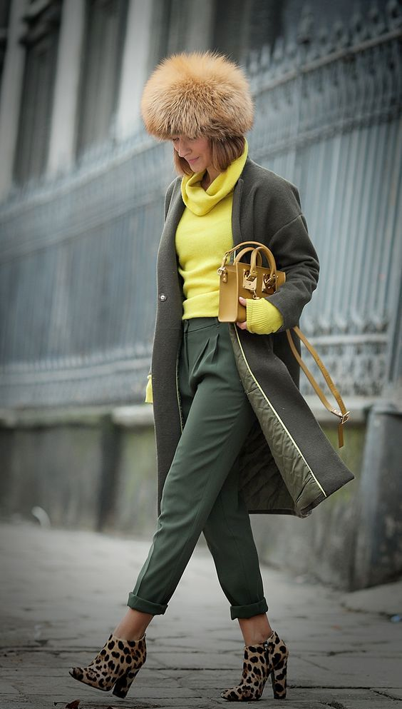 a dark green bag and cropped pants, leopard boots, a neone yellow sweater and a mustard bag