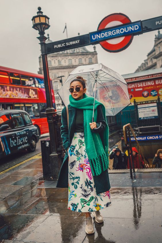 a dark green turtleneck, a floral idi skirt, trainers, a teal coat and an emerald scarf for a bright statement