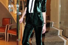 03 a holiday look with an emerald velvet pantsuit, a white shirt with a black bow and gold shoes