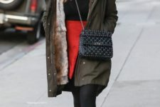 03 a red skirt, a black top, an olive green parka, black combat boots and a bag by Jessica Alba