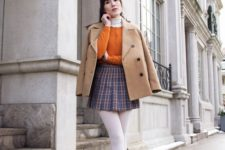 03 a vintage preppy look with a plaid mini, a white turtleneck, a mustard cardigan, white tights, a beige coat and nude shoes