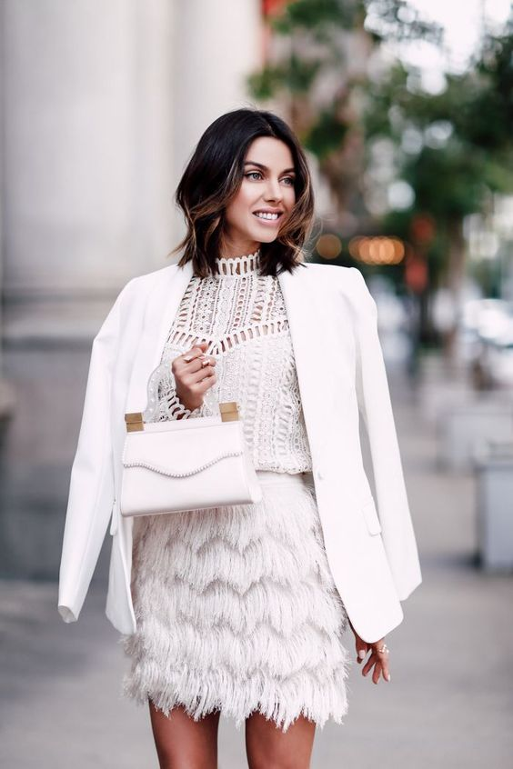 a white crochet lace top, a white feather mini skirt, a white blazer and a white bag