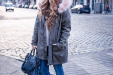 03 a white sweater, blue skinnies, white sneakers, a grey parka with faux fur and a bag