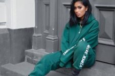 03 an emerald tracksuit and graphite grey sock boots are a style statement for daring girls