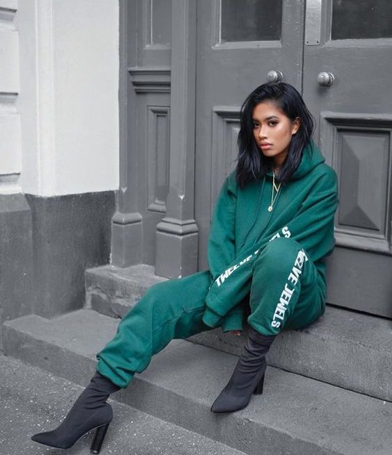 an emerald tracksuit and graphite grey sock boots are a style statement for daring girls