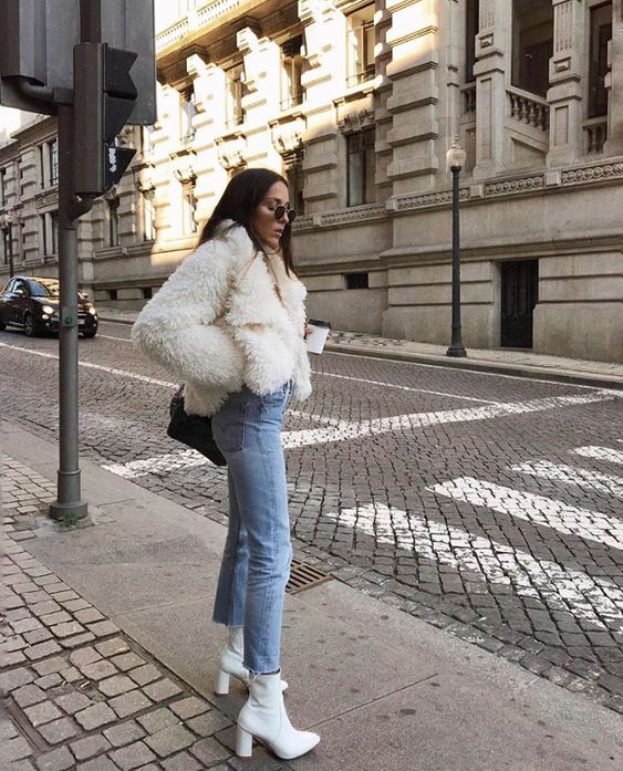 put on white boots and a faux fur coat to echo with each other to look chic