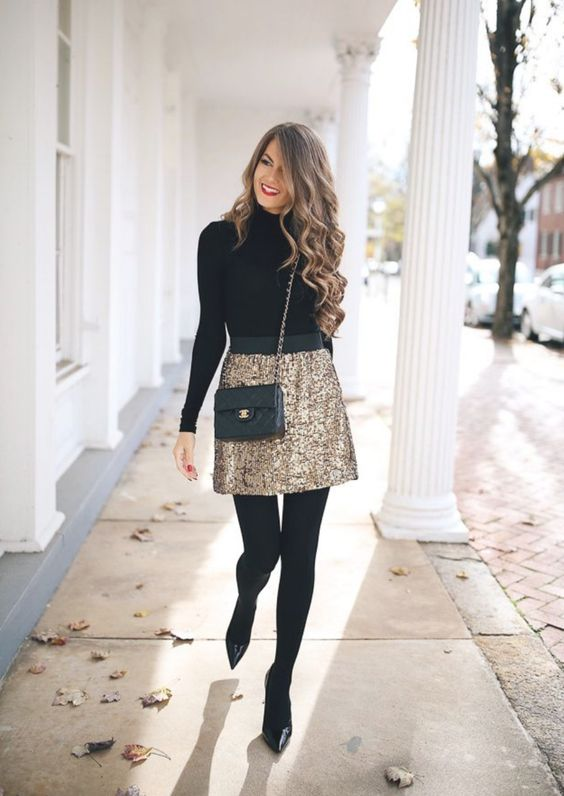 a black turtleneck, a gold glitter mini skirt, black tights, blakc heels and a black bag