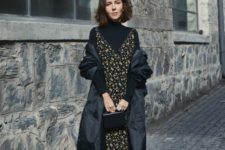 04 a black turtleneck, a moody floral midi dress over it, sock boots, a small bag and a puff midi coat