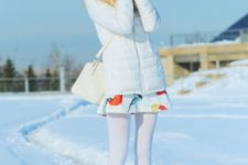04 a girlish look with a bright printed mini dress, creamy boots, white tights, a white puffed coat, creamy mittens and a bag