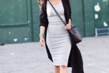 04 a grey bodycon knee dress, a black duster cardigan, black sock boots and a bag