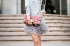04 a grey feather mini skirt, a grey sweater, matching pumps and a pink clutch for a more neutral look