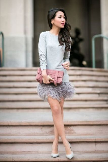 a grey feather mini skirt, a grey sweater, matching pumps and a pink clutch for a more neutral look