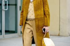 04 a monochromatic outfit with pale yellow pants, an embellished top, a white turtleneck, a mustard fur coat and neutral sneakers