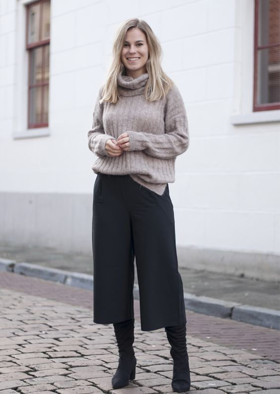 a taupe turtleneck sweater, black culottes, black boots for a comfy winter look