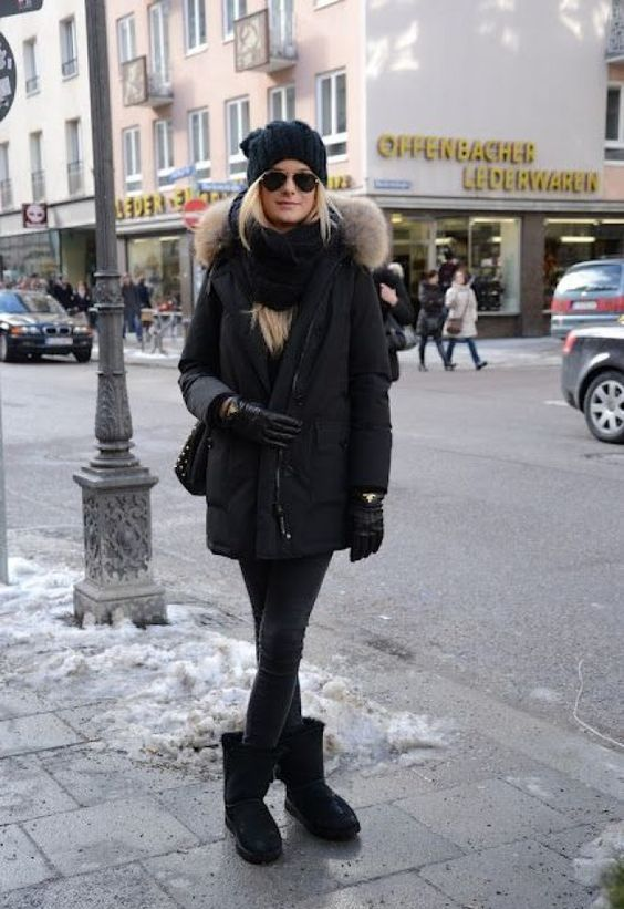 a total black look with jeans, a parka, gloves, a scarf and a beanie is a chic idea