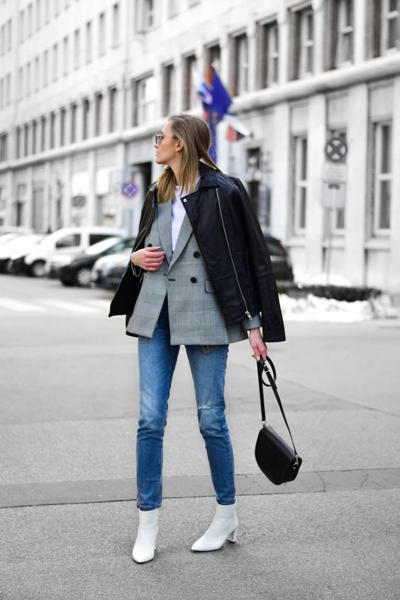 a white tee, a grey plaid blazer, a black leather jacket, white boots and a black saddle bag