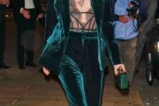 04 an emerald velvet pantsuit with a lace corset and a green clutch for an ultimate holiday look