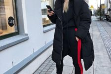 05 a black and red tracksuit, a midi puff coat, black trainers and a cap for a fully sport look