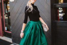 05 a black turtleneck, an emerald A-line midi skirt, black heels and a shiny clutch create a playful look