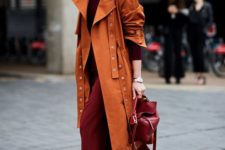 05 a burgundy midi sweater dress, a matching bag, a rust trench and white boots to stand out