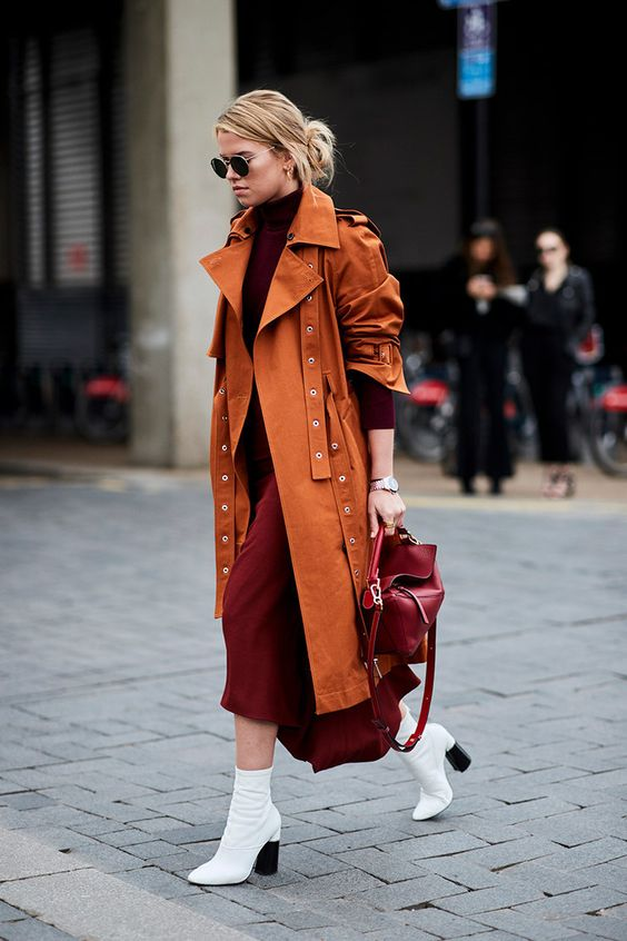 a burgundy midi sweater dress, a matching bag, a rust trench and white boots to stand out